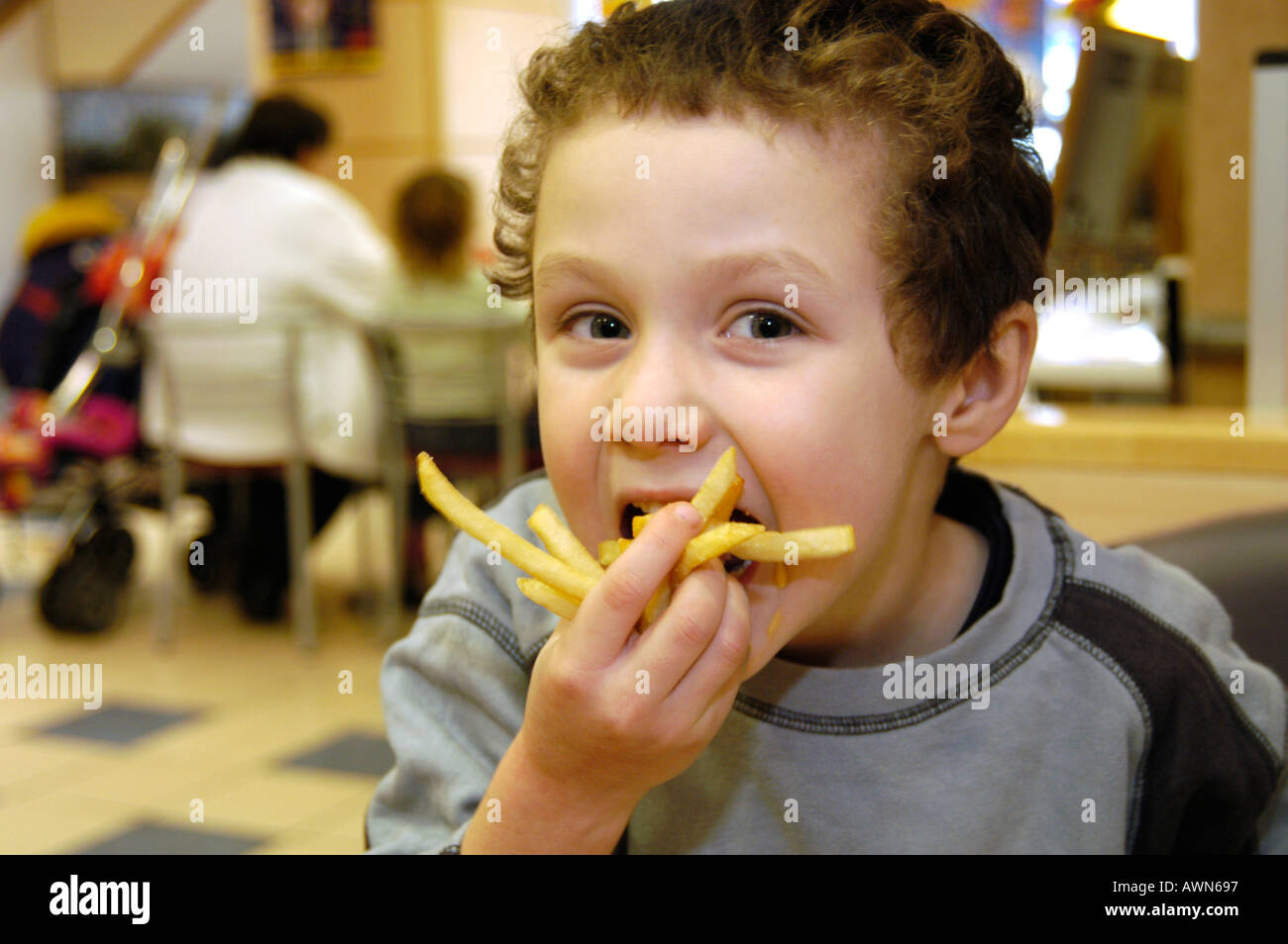 junk food and kids uk stock photos junk food and kids uk stock small boy eating mcdonald s french fries england uk stock image