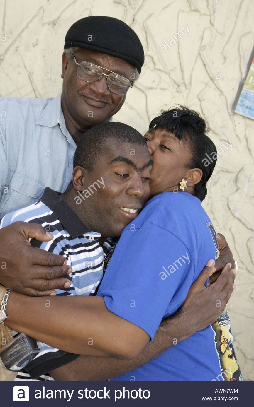 mentally disabled Black man grandparents family hug love ...