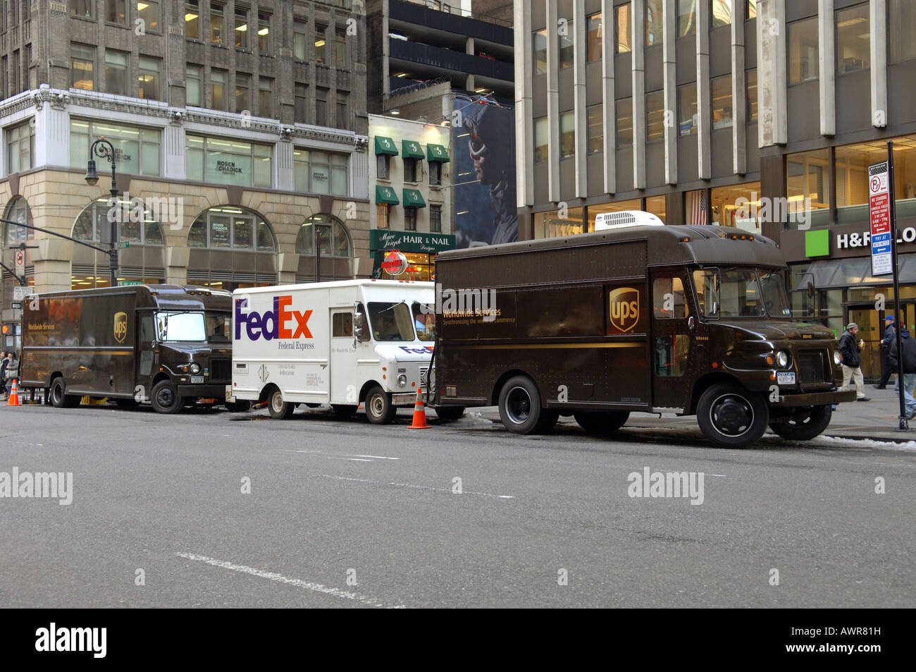 New York Pick Up Truck >> UPS trucks surround a FedEx truck parked in the Garment Center in NYC Stock Photo, Royalty Free ...