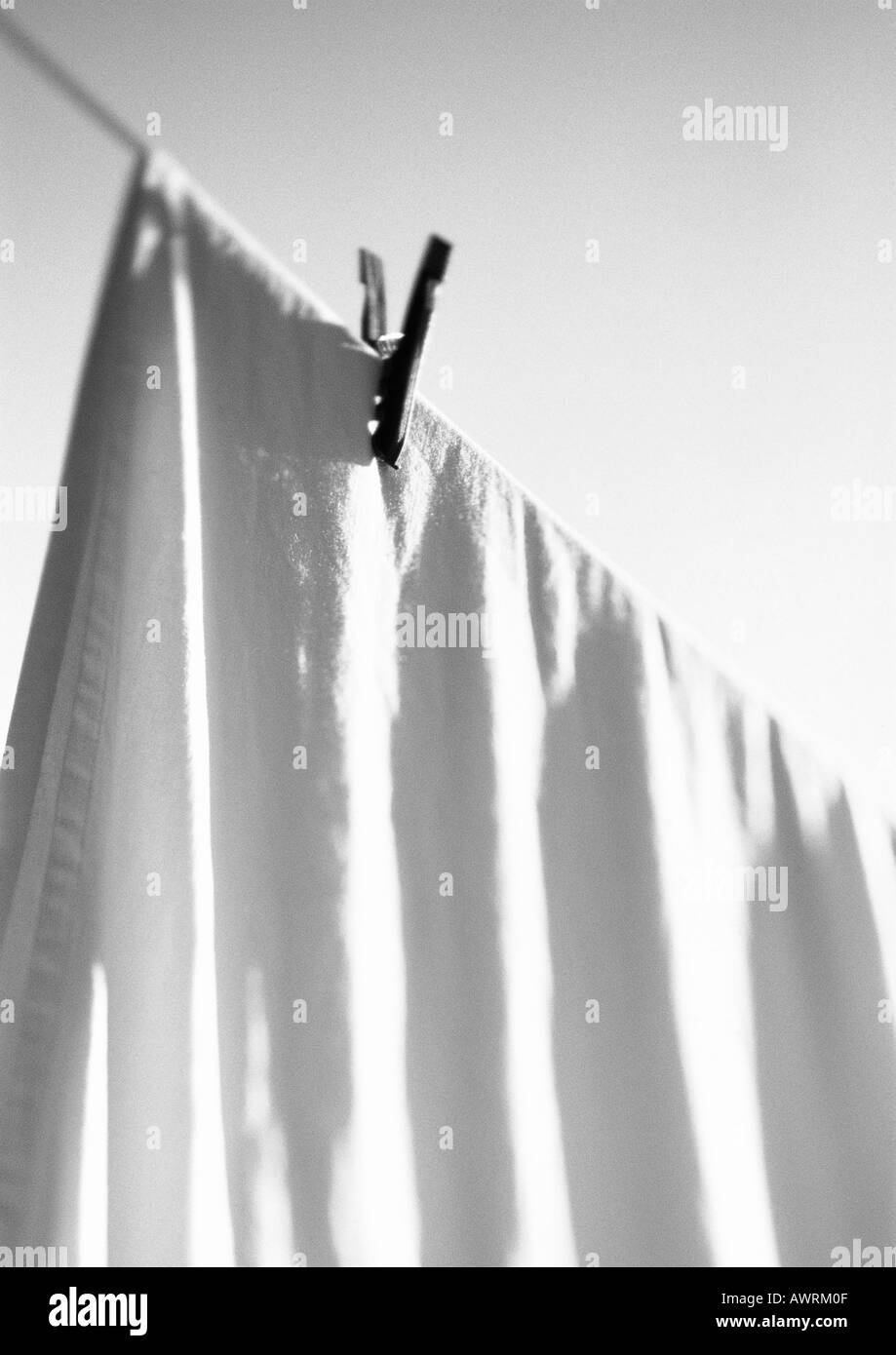Bed sheet hanging - Bed Sheet Hanging On Line With Clothes Pin B W