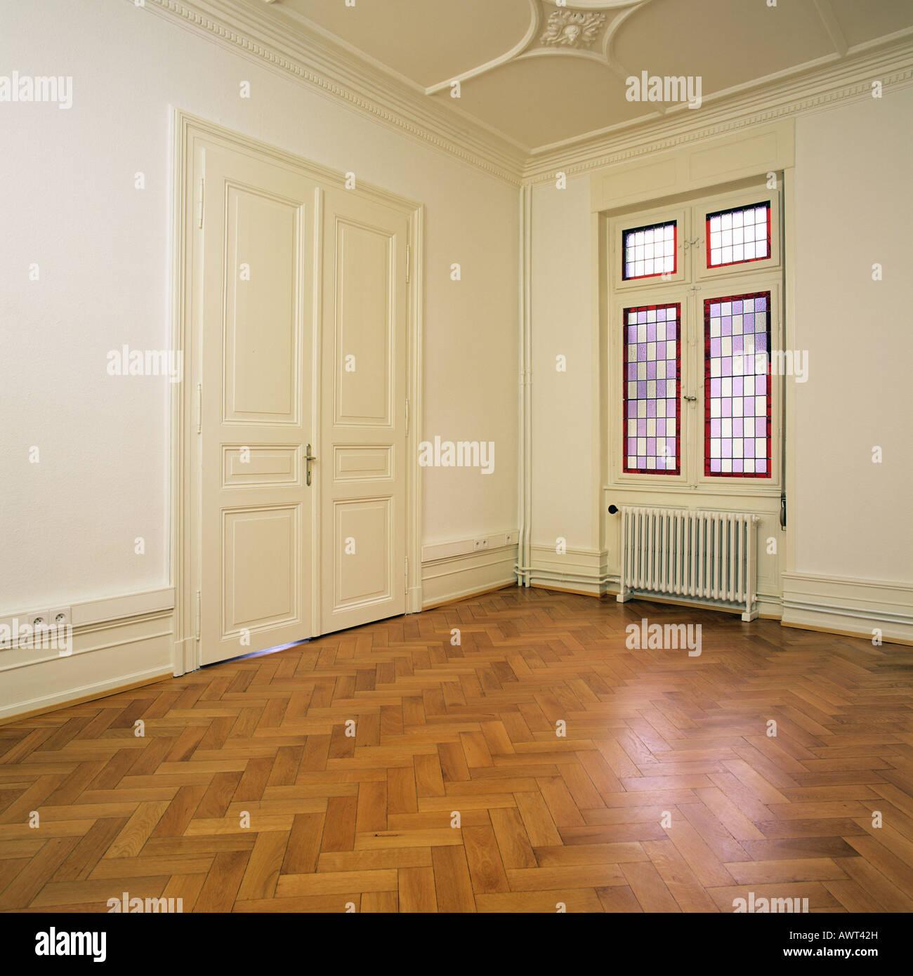 PR EMPTY ROOM WITH OAK WOODEN FLOORING CLOSED DOOR AND A ...