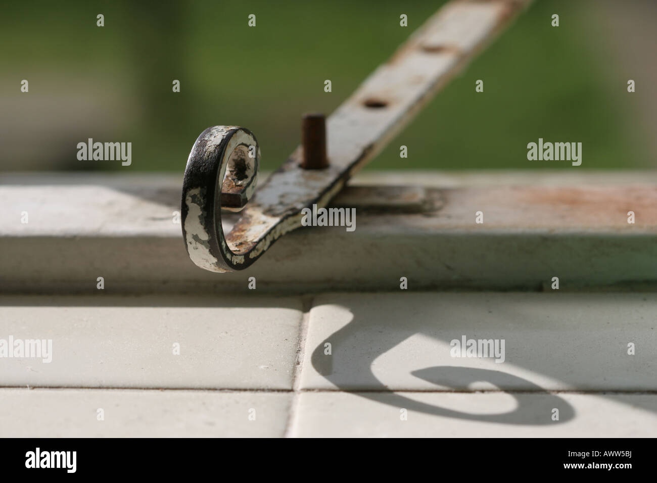 Stock Photo - White spiral window latch holding unseen window open with view to green grass & White spiral window latch holding unseen window open with view to ... Pezcame.Com
