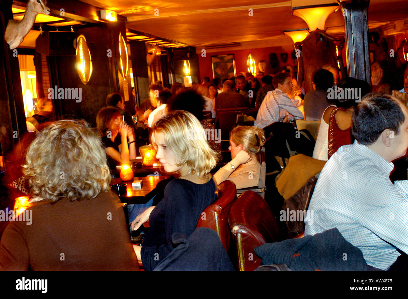 PARIS France Crowd Of People In Dining Room Af Rican Theme Bar Restaurant LImpala Lounge Night