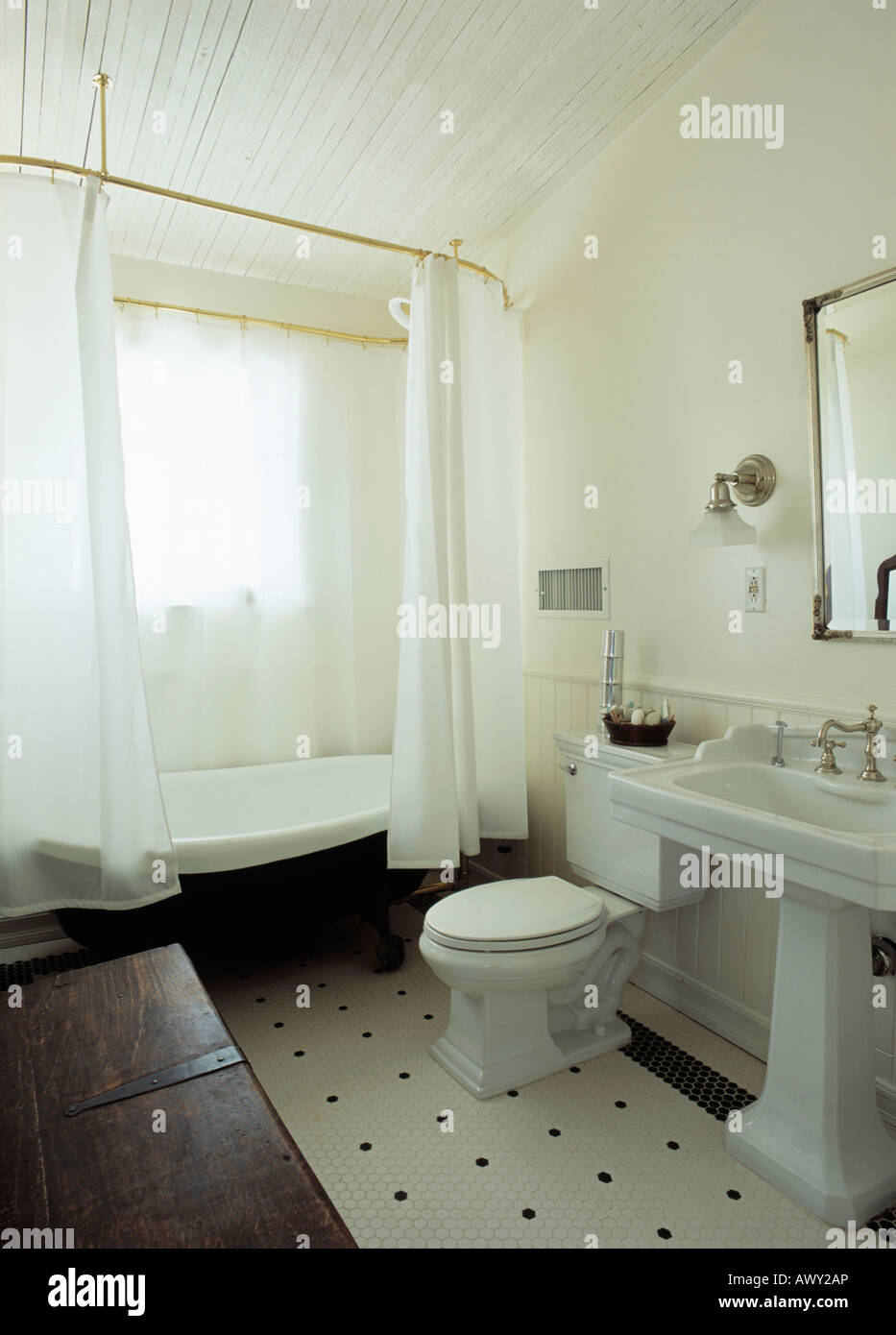 Stock Photo   White Shower Curtains On Freestanding Bath In Traditional White  Bathroom With White Pedestal