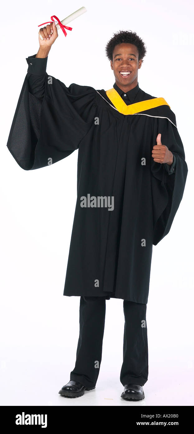 Young Man Wearing Graduation Gown Uid 1448348 Stock Photo, Royalty ...