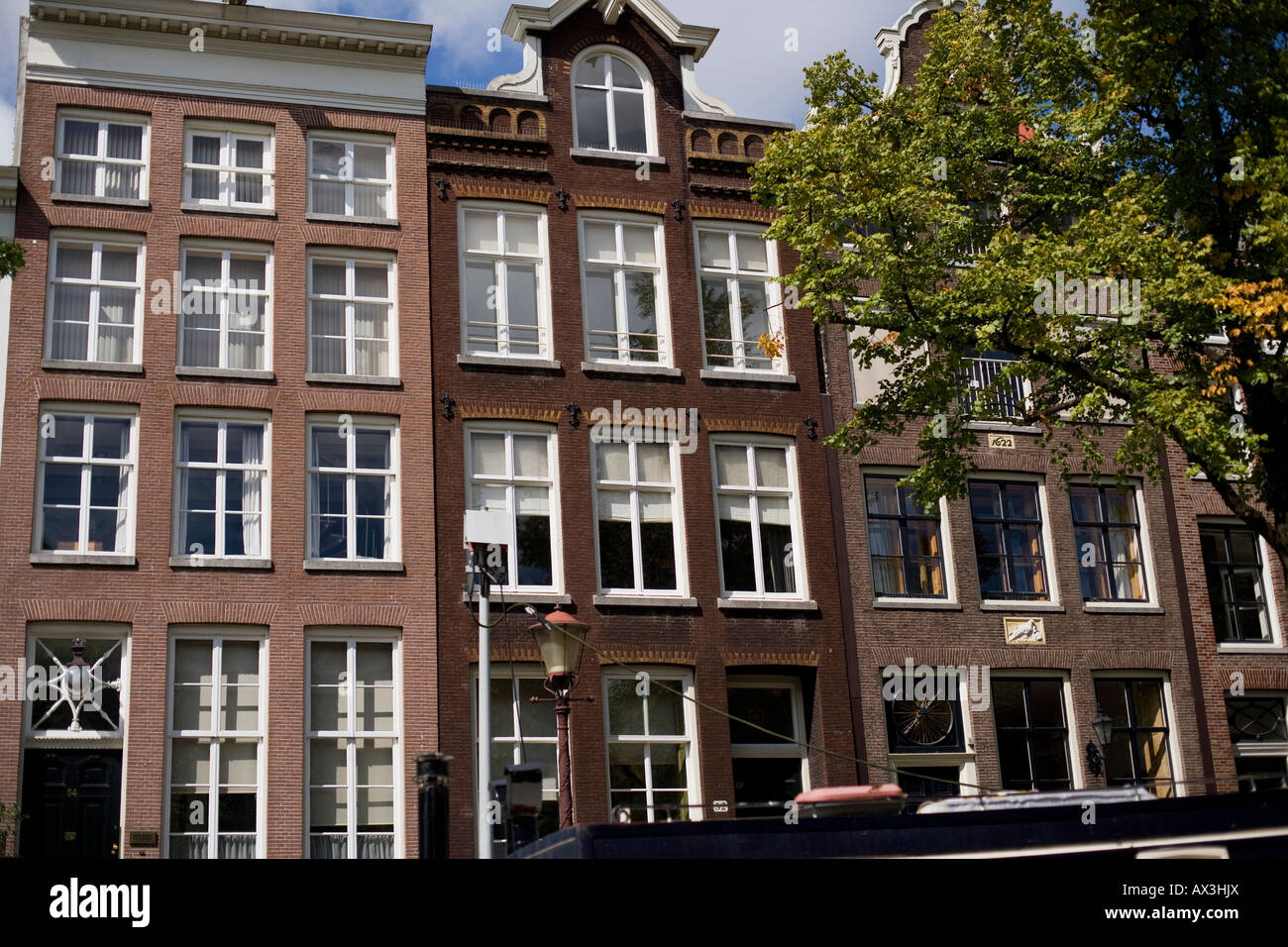 a row of red brick apartment buildings, distinguished by the white ...