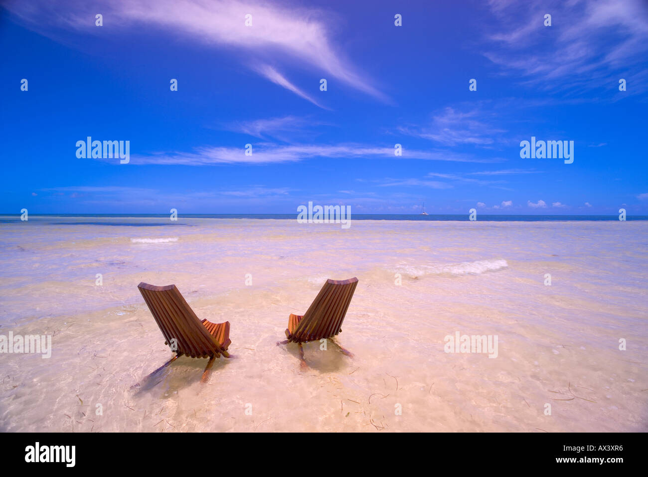 Two Beach Chairs In Shallow Water In Key West, Florida, USA