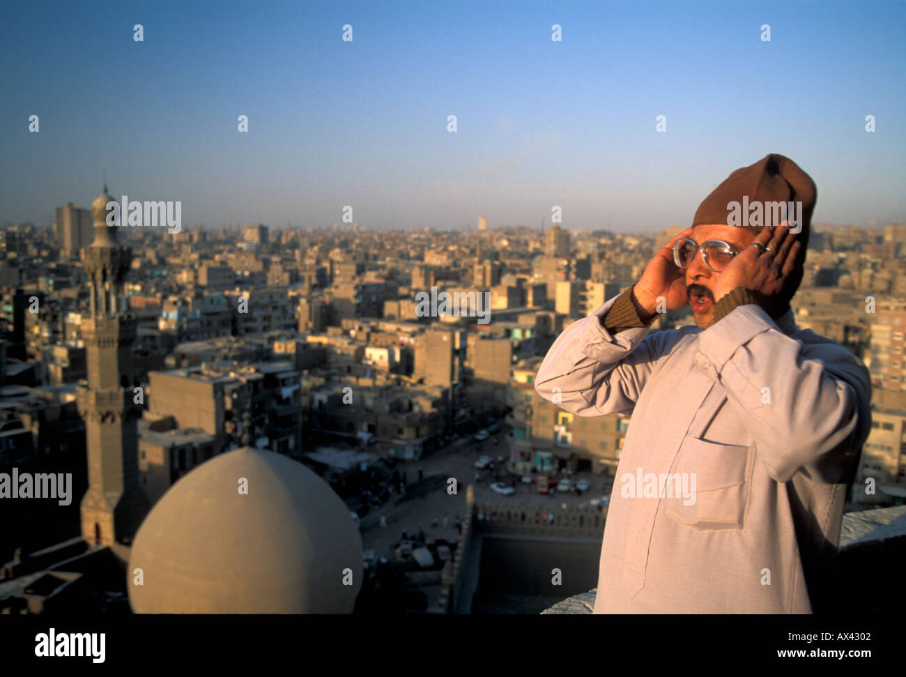 An Imam making the shahada prayer call from the Ibn Tulun Mosque ...