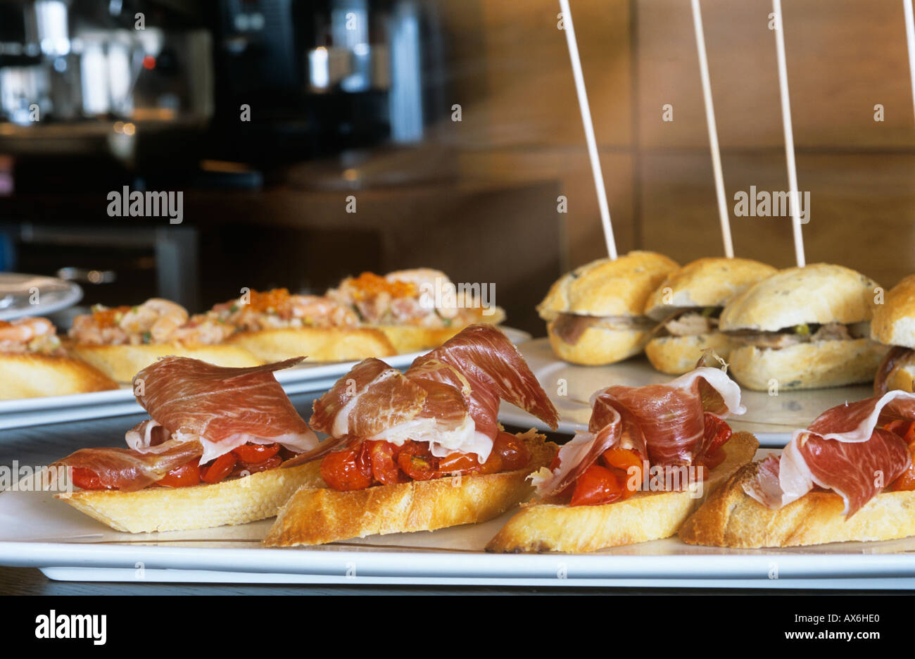 Tapas neatly arranged in spanish tapas bar authentic spanish stock photo royalty free image for Cuisine bar tapas