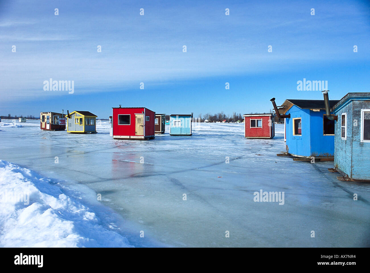 Ice fishing cabins standing on frozen st lawrence river for Fishing in quebec