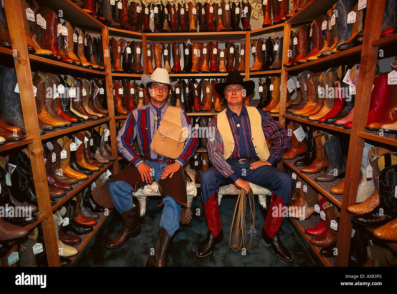 Two men wearing cowboy hats in a shop with cowboy boots, Fort ...