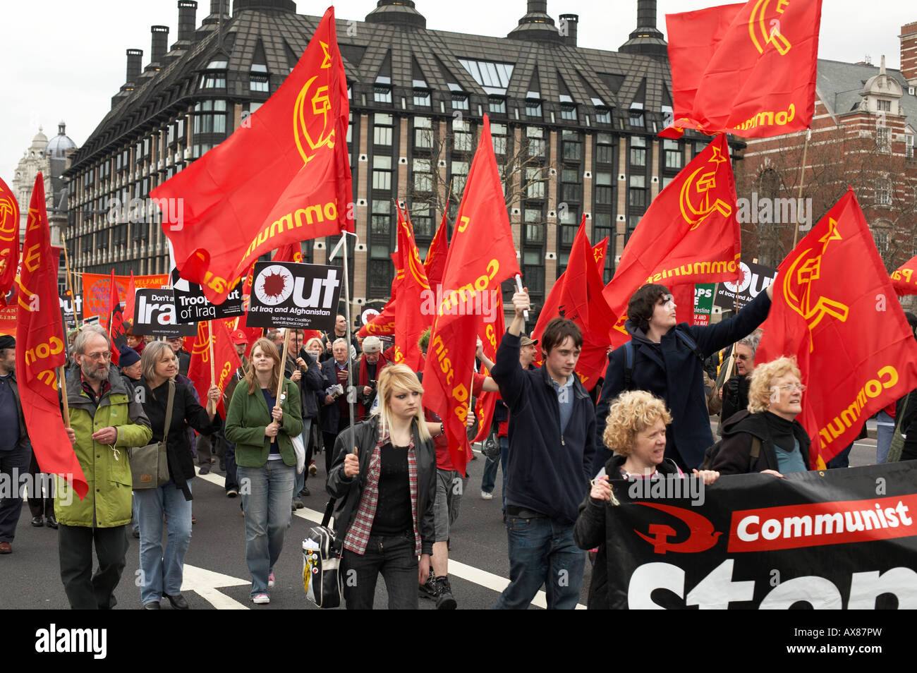 communist flags waving at an anti war rally in london uk
