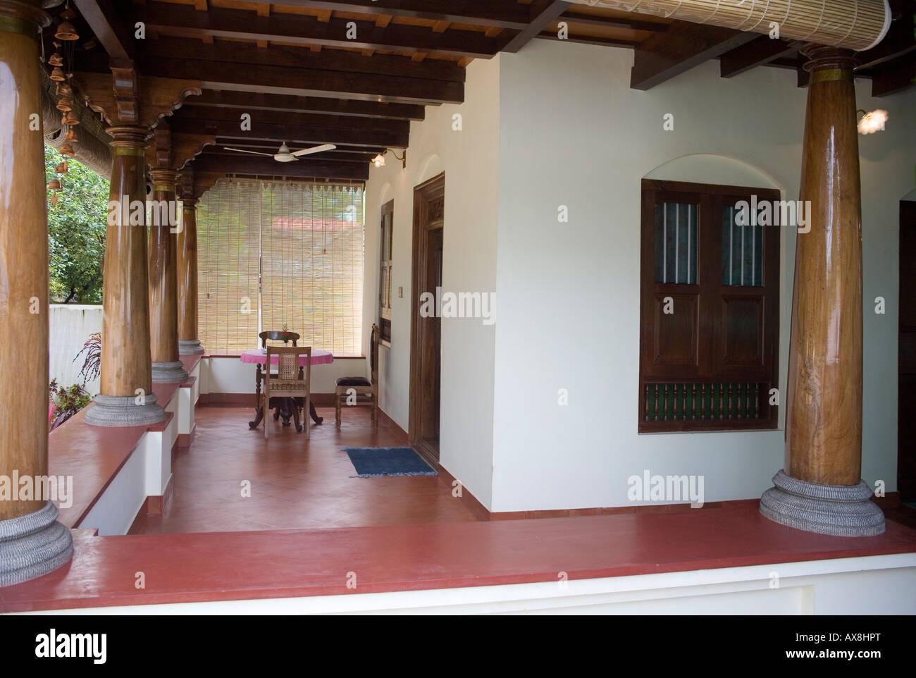 Table for two in airy verandah encircling keralite for Verandah designs in india