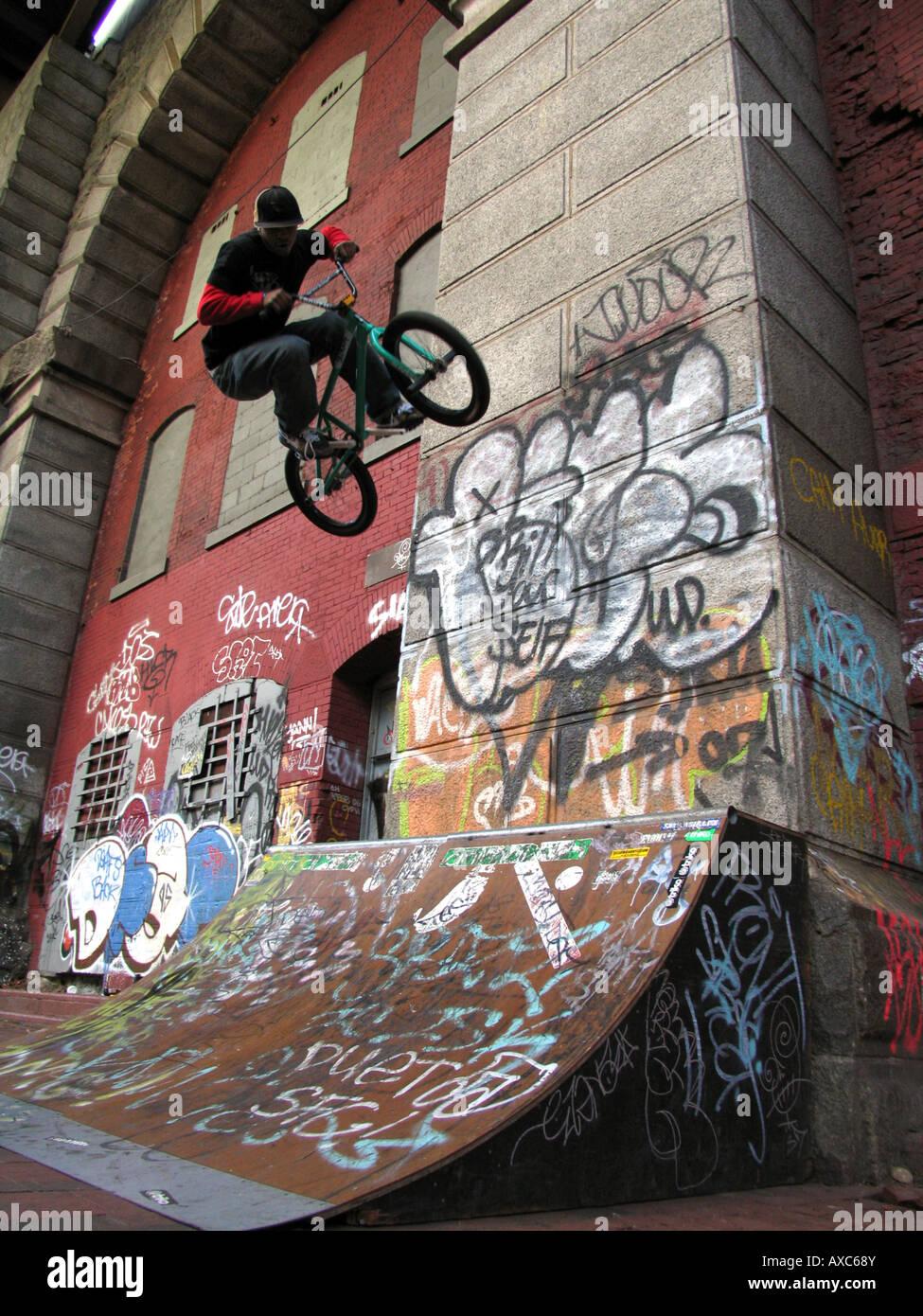 Graffiti wall usa - Bmx Rider After Jumping From Ramp In Front Of Wall With Graffiti Under The Manhattan Bridge Usa Manhatten New York
