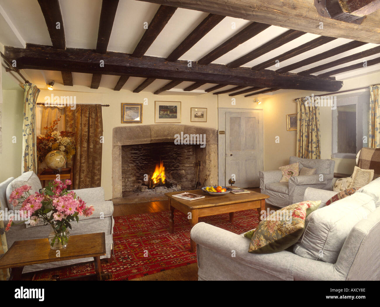 Traditional Sitting Room With Oak Beams And A Large Fireplace