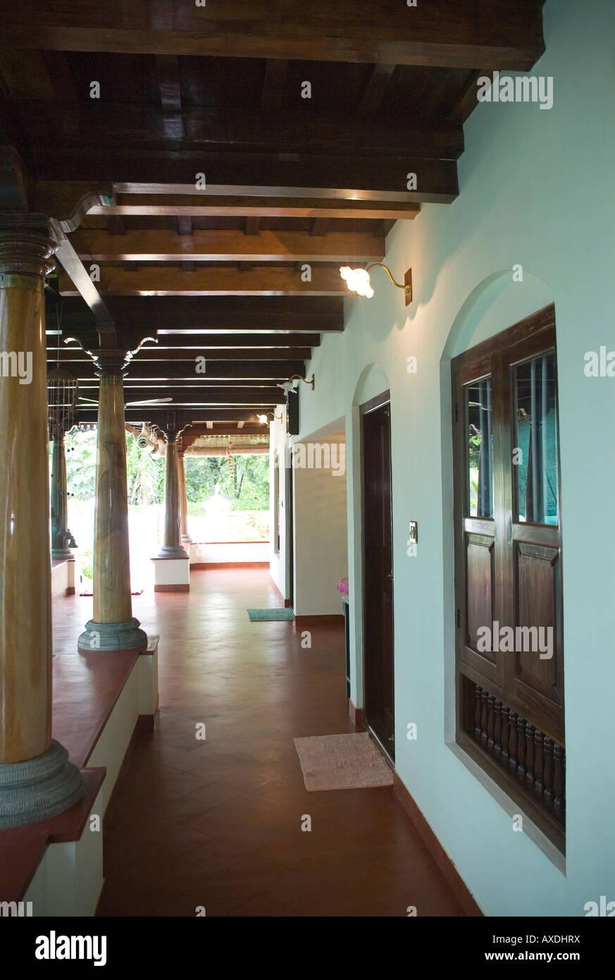 Part of airy verandah encircling keralite bungalow styled for Verandah designs in india