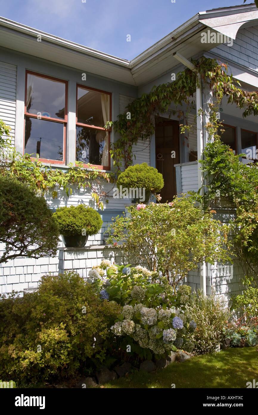 Garden and pot plants on wooden house veranda Victoria ...