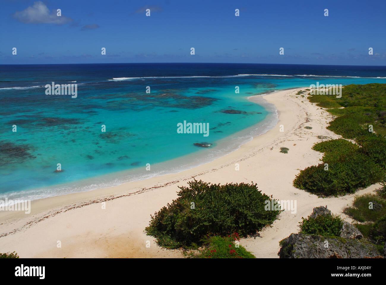 Pristine, unspoilt tropical Dickenson Bay beach, landscape and ...