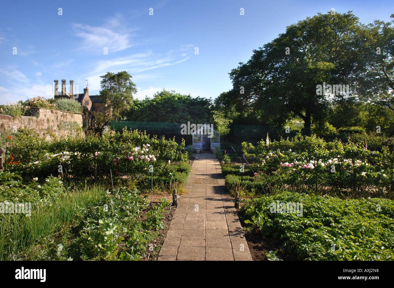 Kitchen Garden Farm A Garden Path Leading To A Greenhouse In The Walled Kitchen Garden
