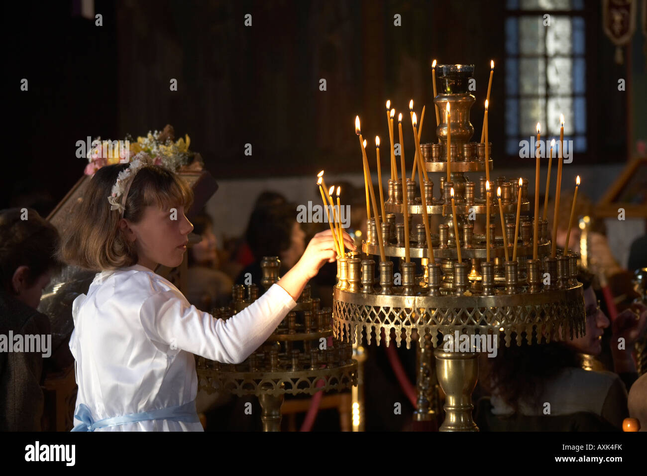 Young girl lighting candles before Easter Good Friday evening service in Greek orthodox church in Saronida Attica Atiki Greece  sc 1 st  Alamy & Young girl lighting candles before Easter Good Friday evening ... azcodes.com