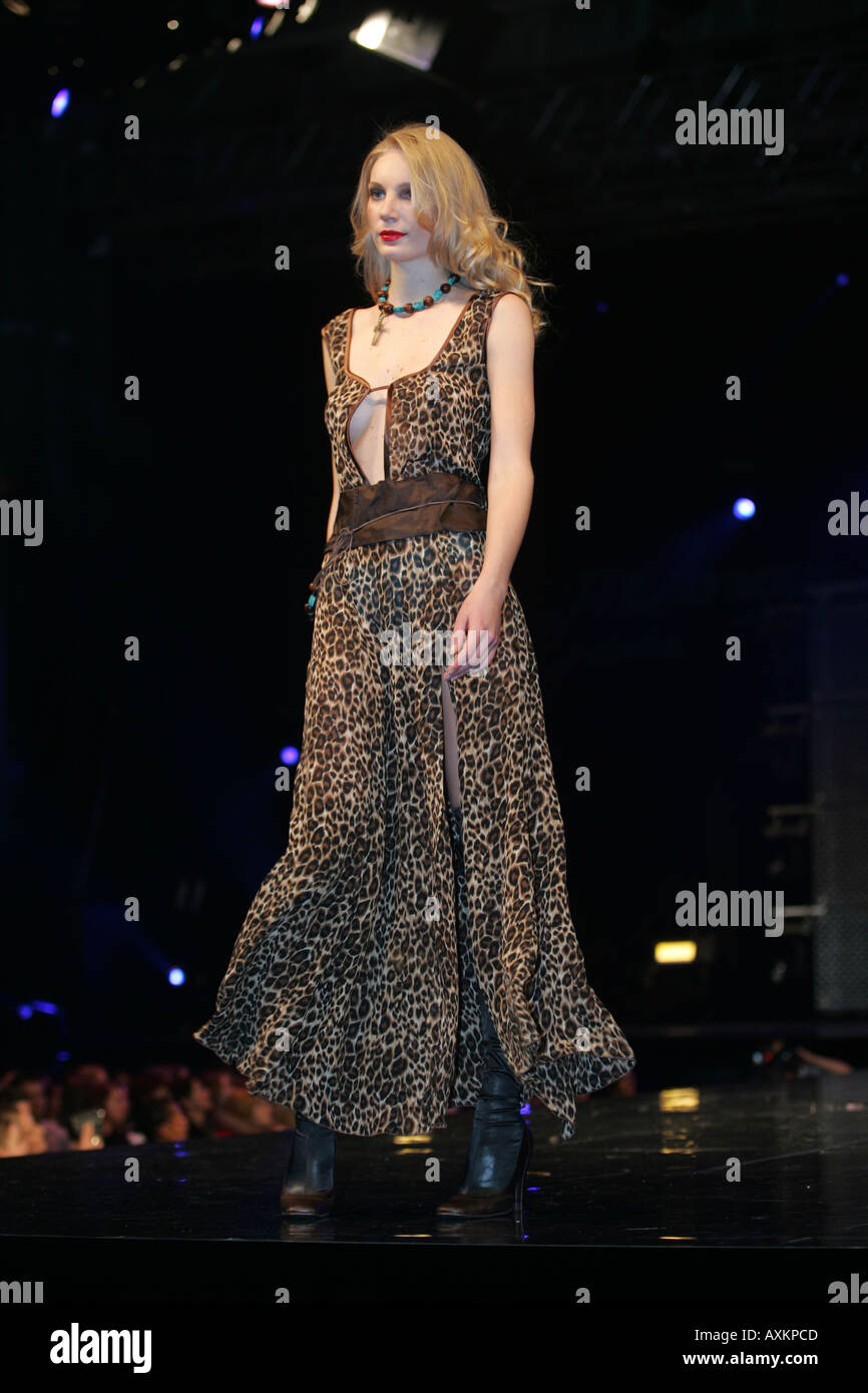 model wearing animal print dress at the clothes show nec