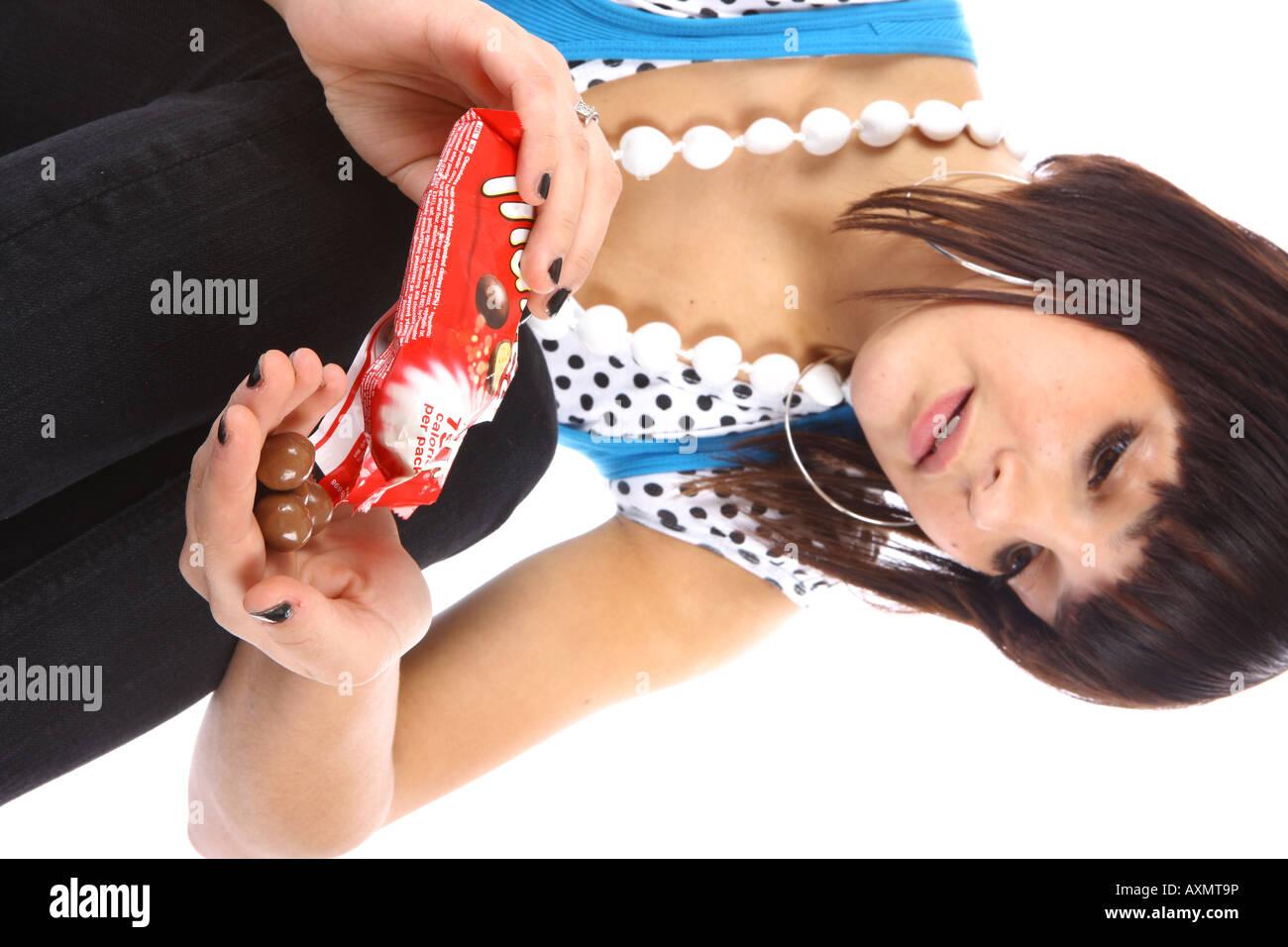 Teenage Girl Eating Chocolate Model Released Stock Photo, Royalty ...