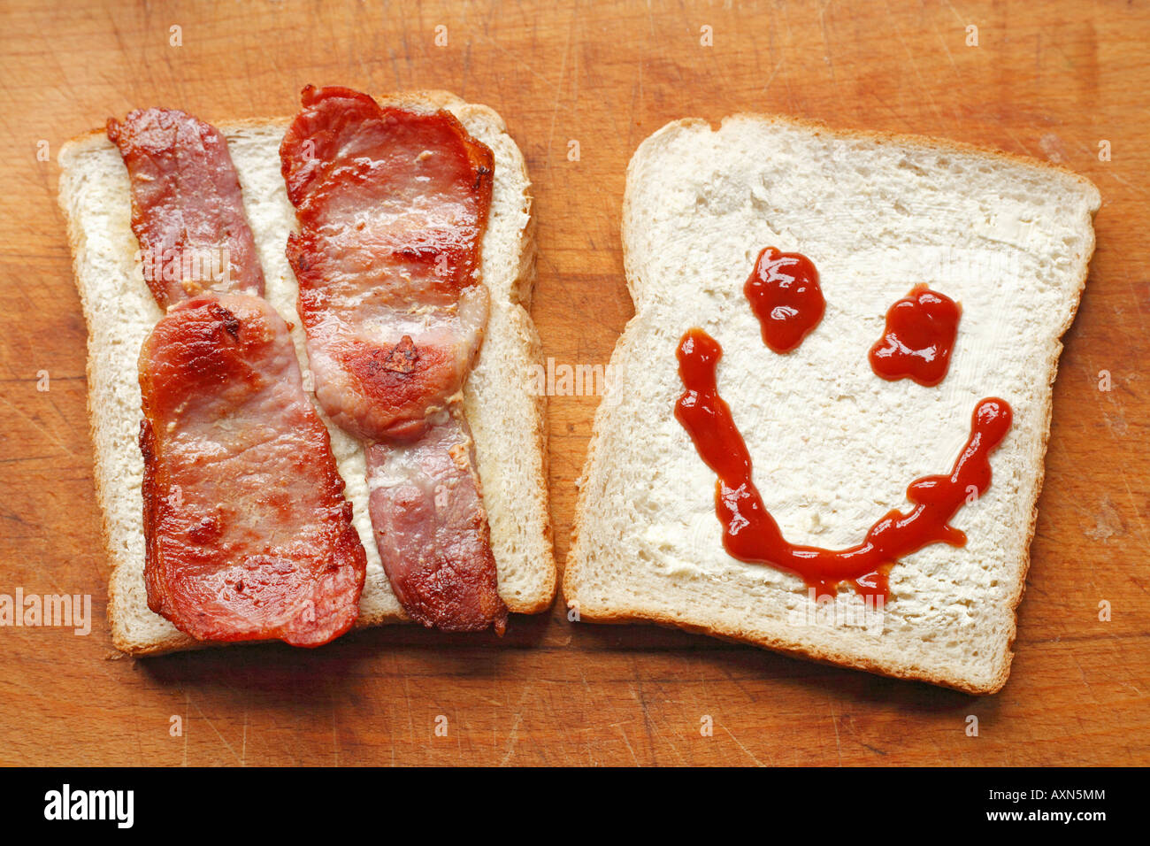 Making A Bacon Sandwich With A Smiley, Ketchup Face