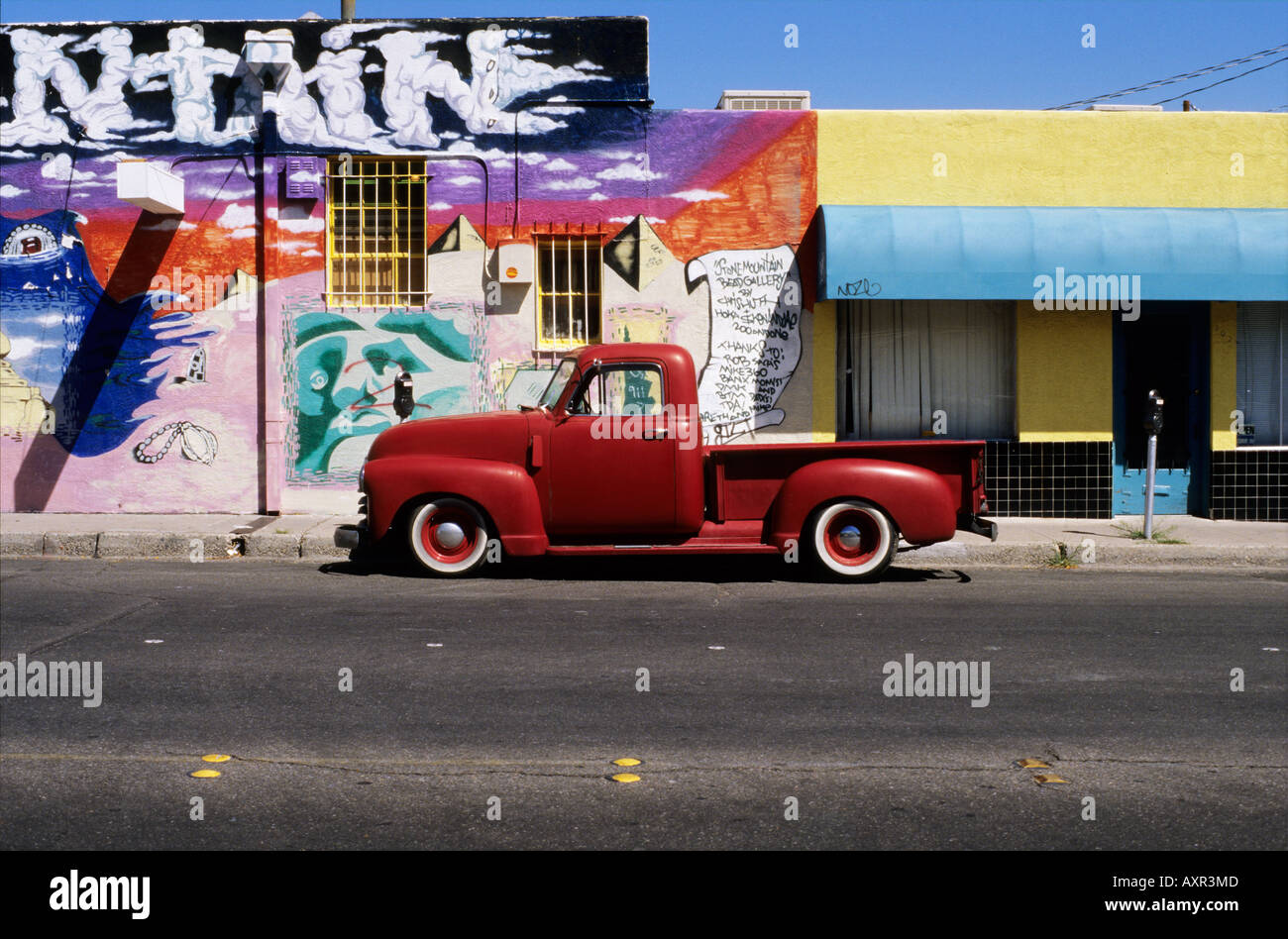 An old red Ford pickup truck parked on the street in Albuquerque ...