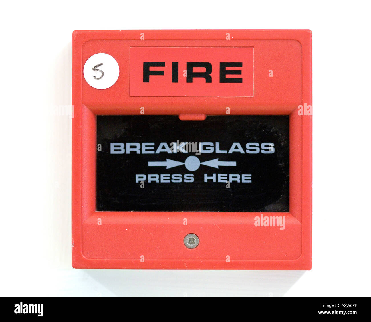 fire break glass here button alarm red box on wall stock