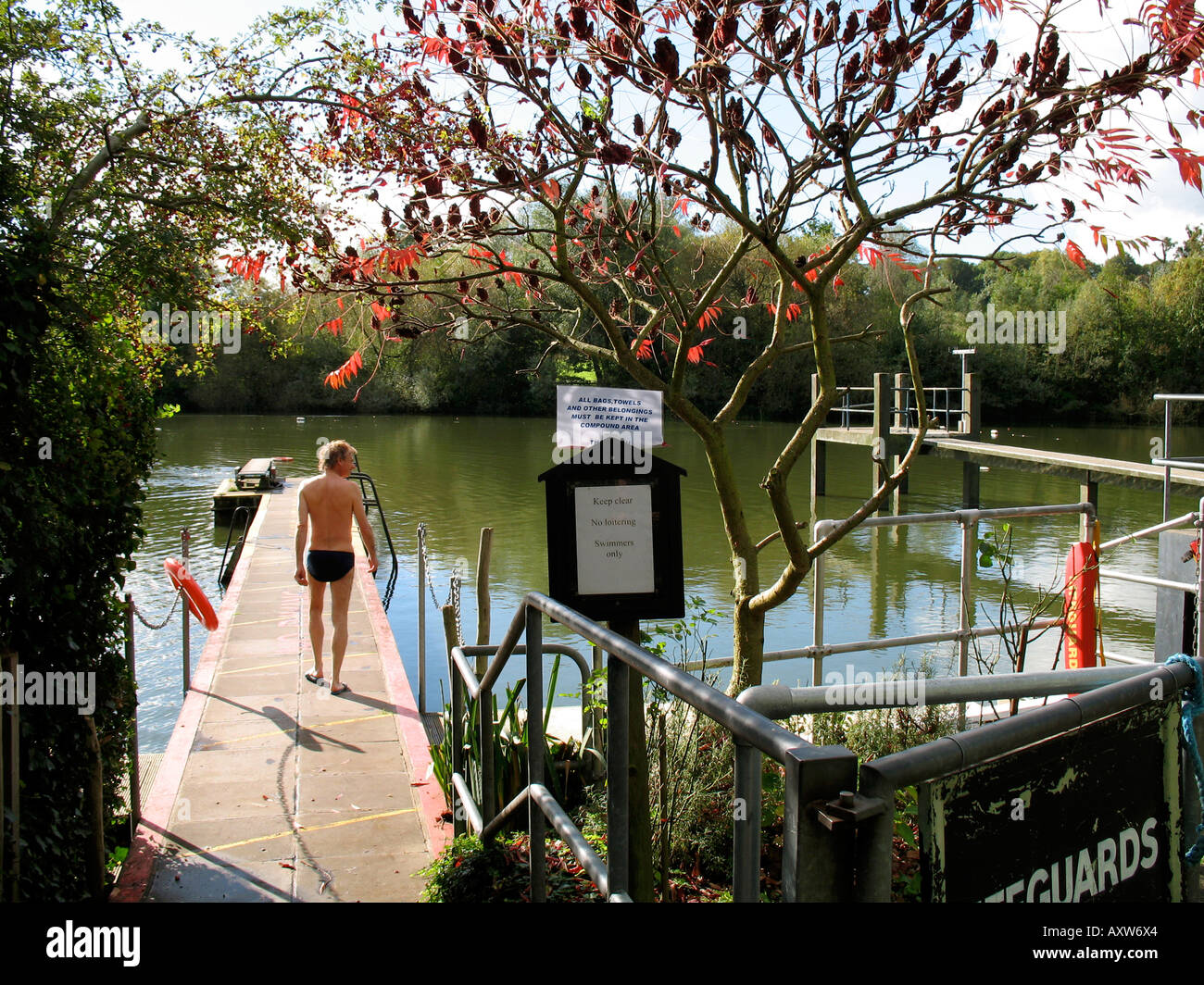 A man at the mens swimming pond on hampstead heath london england stock photo royalty free for Hampstead heath park swimming pool