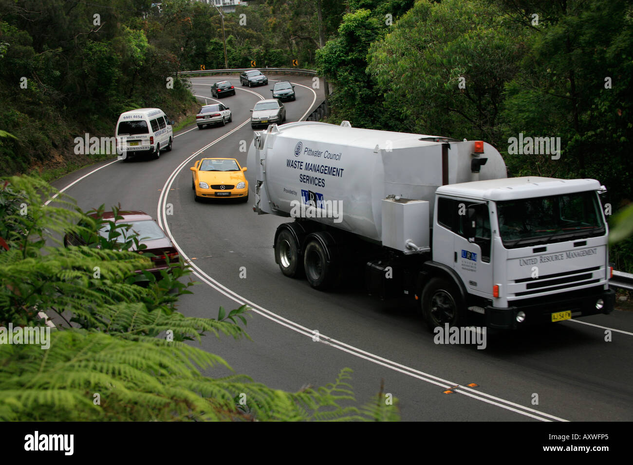 A Waste Disposal Truck Delays Traffic Behind It On The Winding S - Avalon truck