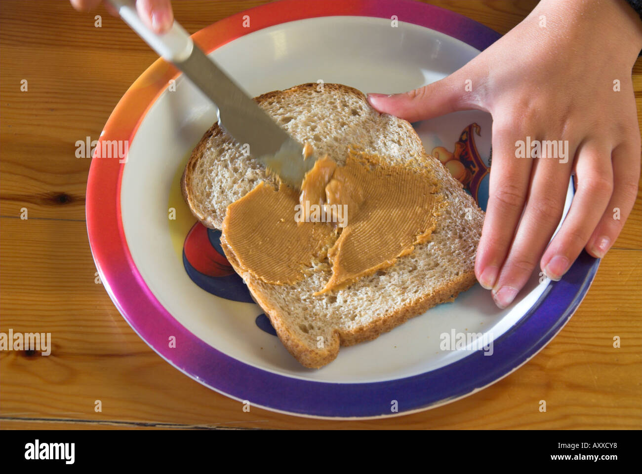 Stock Photo Spreading Peanut Butter On Slice Of Bread 9675703 on Food To Sell