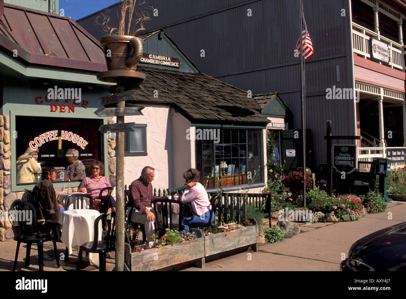 People Drinking Coffee In Outdoor Patio Of A Coffee Shop In The Quaint  Coastal Village Of Cambria California