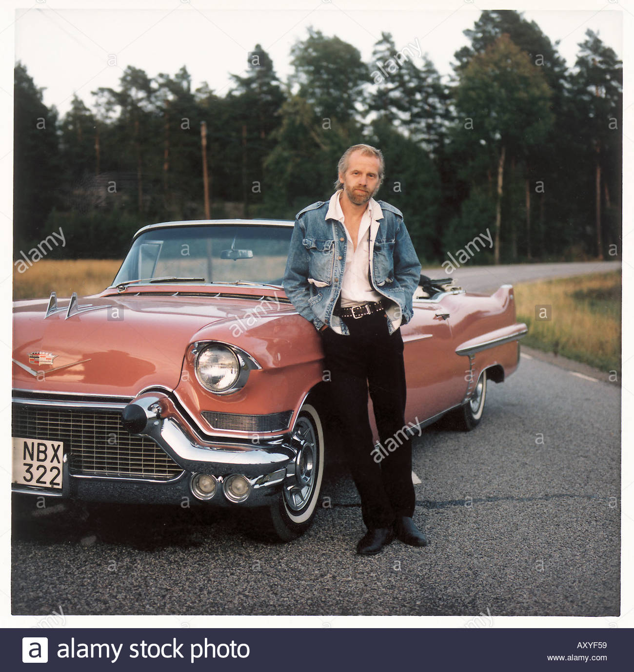 A Man Standing Beside An Old Car Stock Photo, Royalty Free