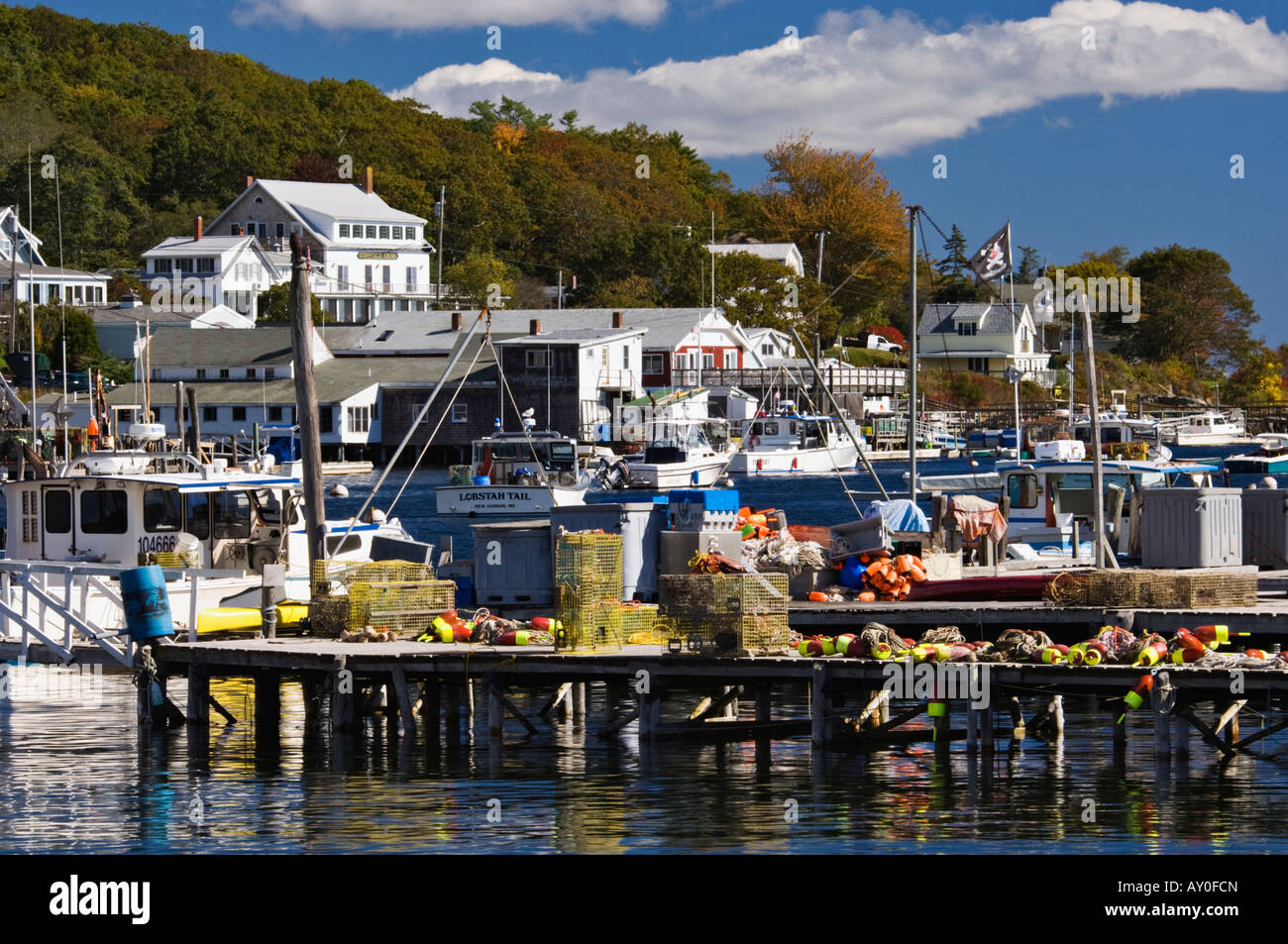 Lobster traps buoys and fishing boats at the docks of new for Lobster fishing in maine