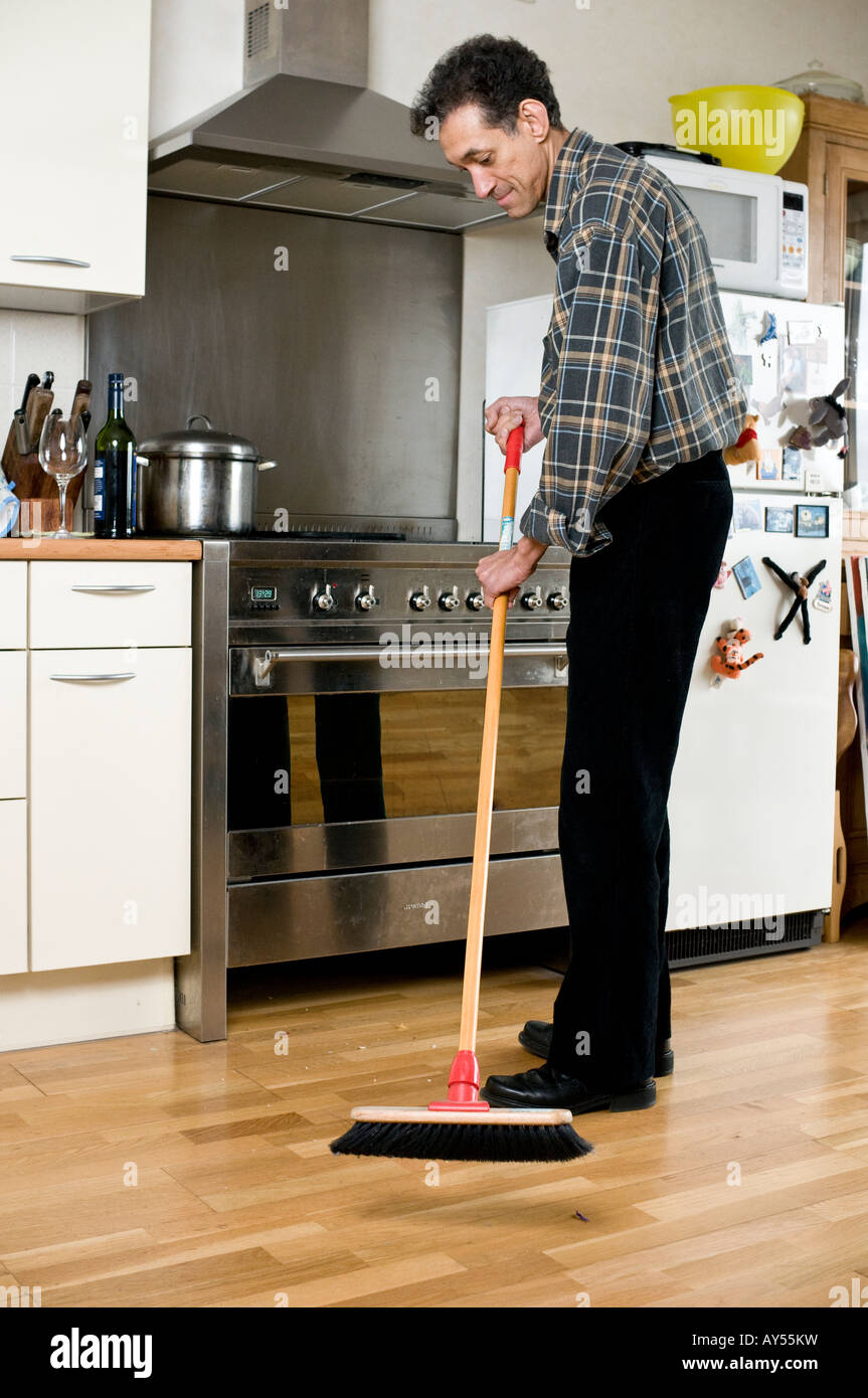 Kitchen Floor Mop Man Sweeping Black Stock Photos Man Sweeping Black Stock Images