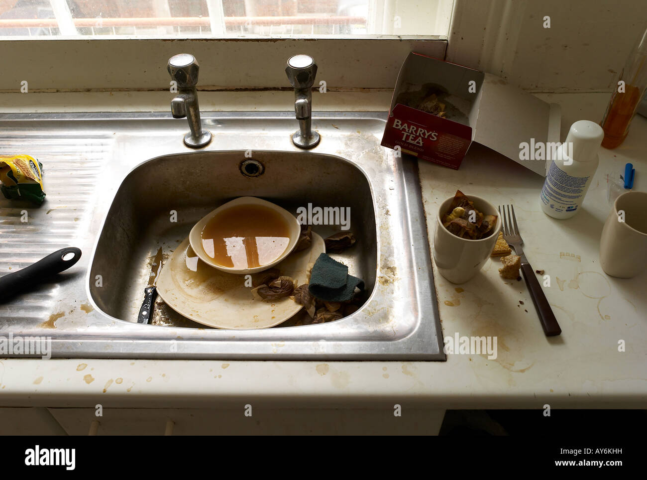 A dirty kitchen sink in an old man s flat Stock Photo, Royalty ...