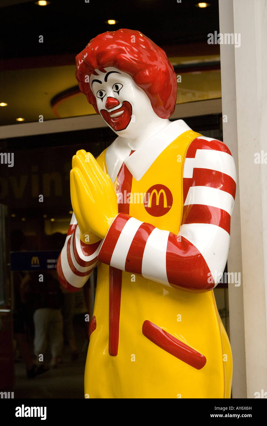 Ronald mcdonald greeting customers with the traditional thai ronald mcdonald greeting customers with the traditional thai greeting called a wai at the entrance to a mcdonalds restaurant ban kristyandbryce Images