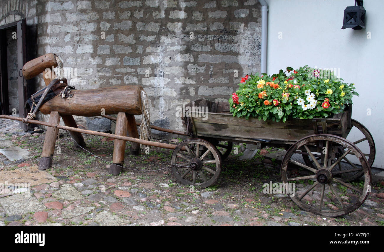 Decorative Wood Horse Pulling An Old Wood Wagon Filled