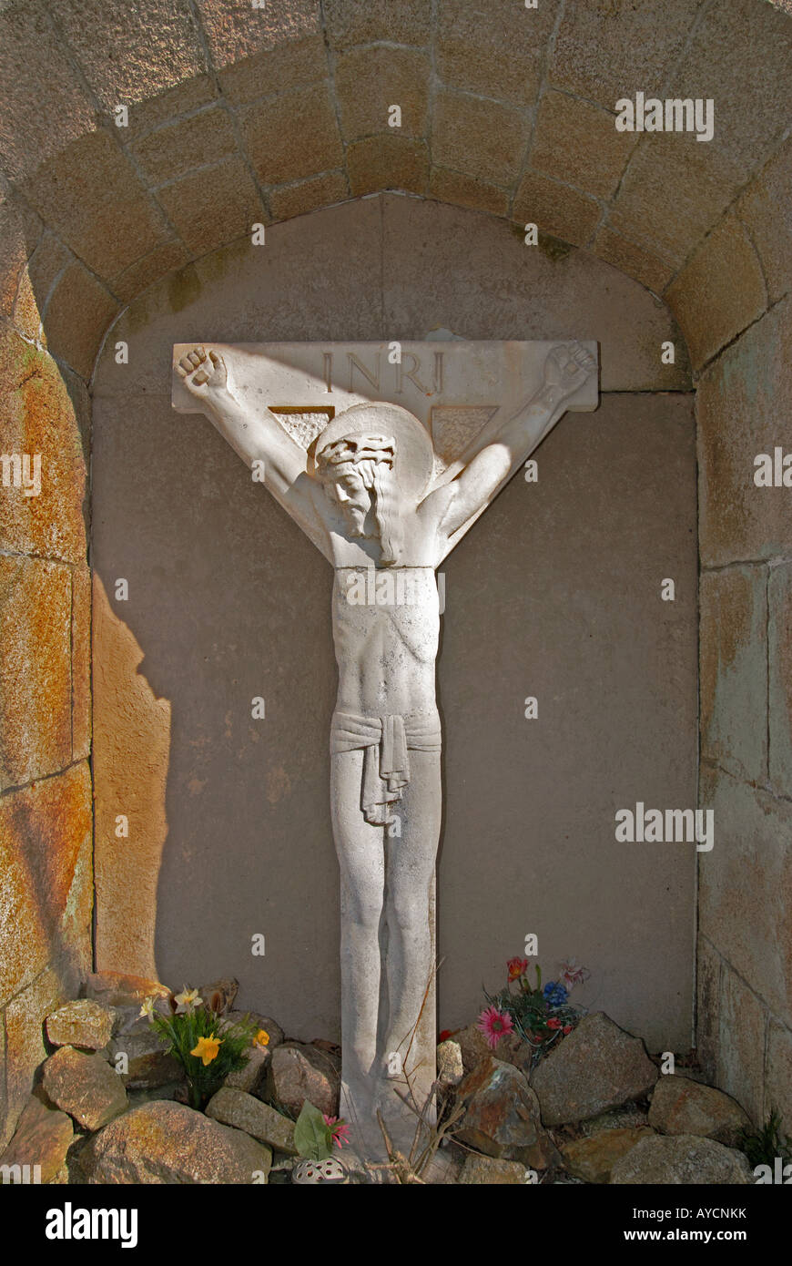 a memorial statue of jesus on the cross stock photo royalty free