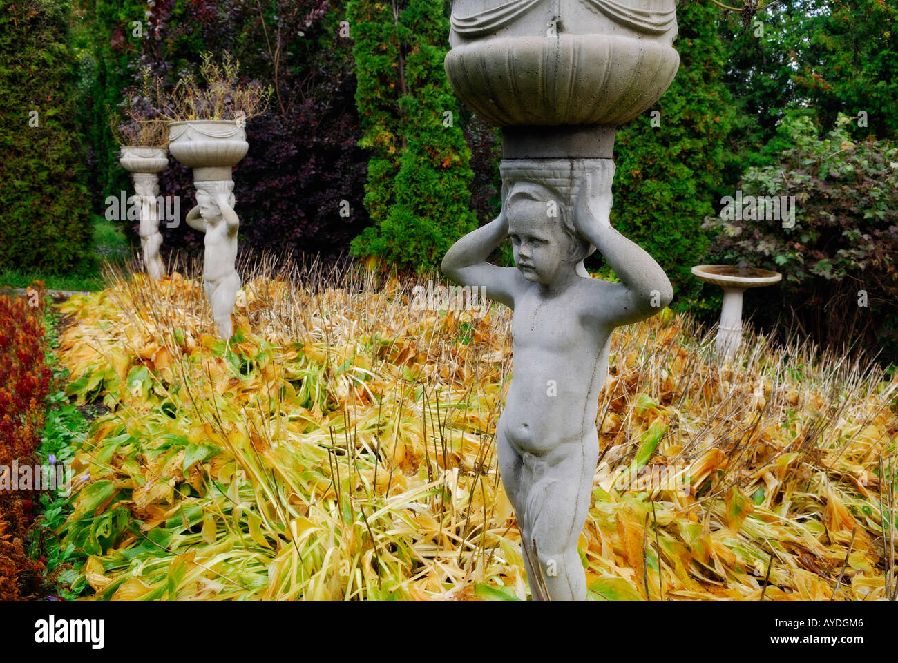 Marvelous Statues Of Young Boys Holding Planters On Their Heads In A Fall Garden  Ontario