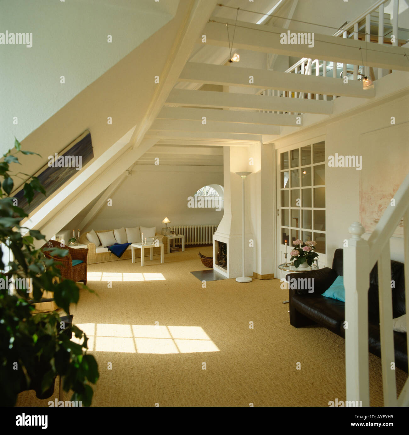 Mezzanine Loft Conversion cream carpet in open-plan white living room in modern country loft