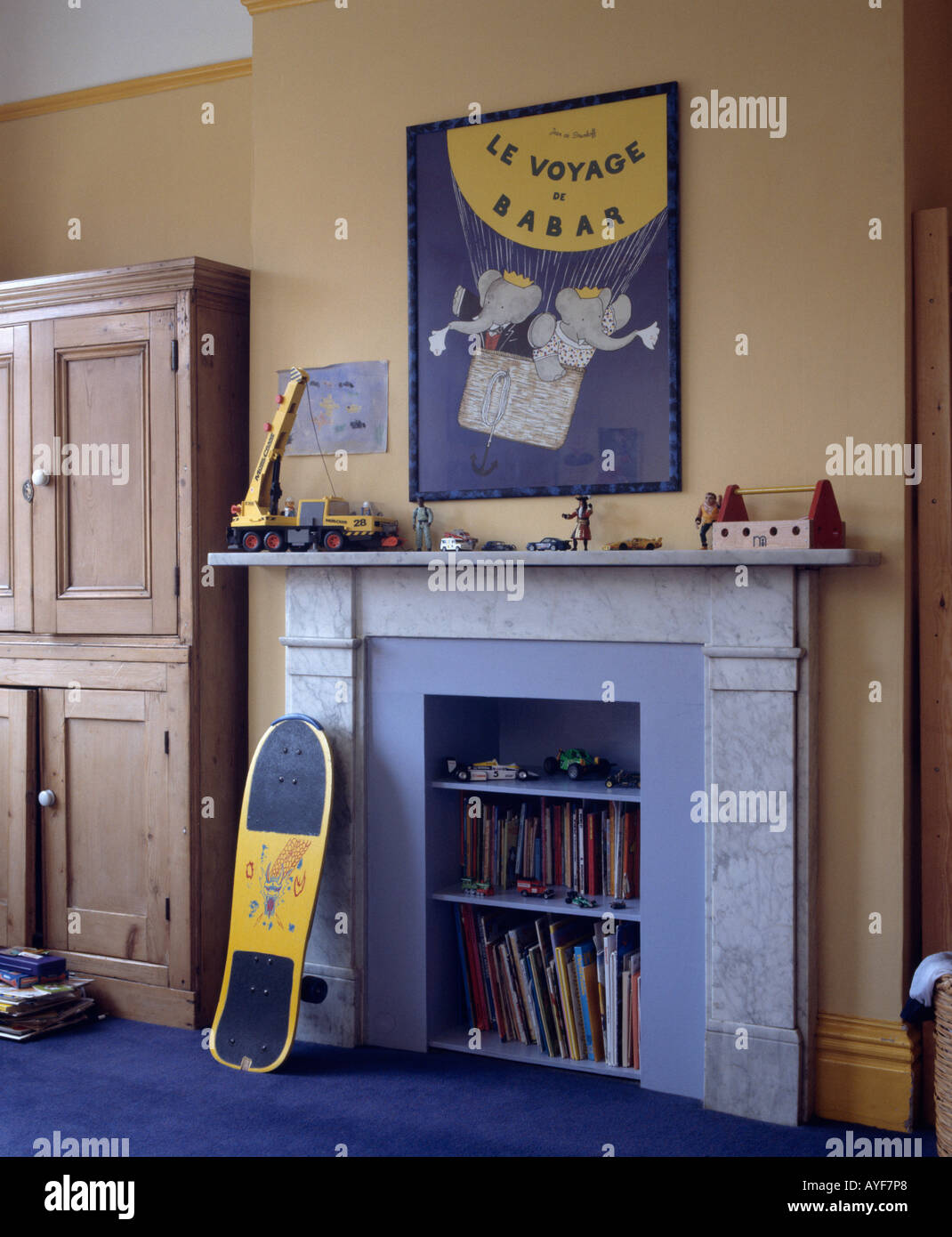 poster above blue painted fireplace with integral shelves in stock