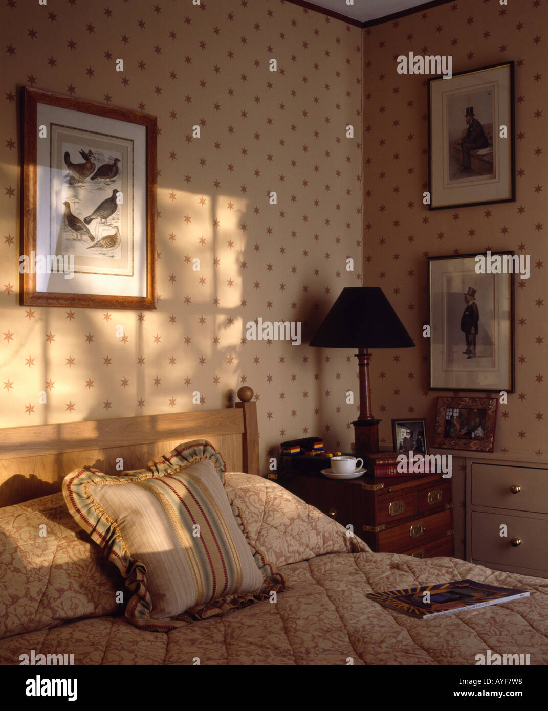 Wallpaper in neutral bedroom with cushions on bed stock for Neutral bedroom wallpaper