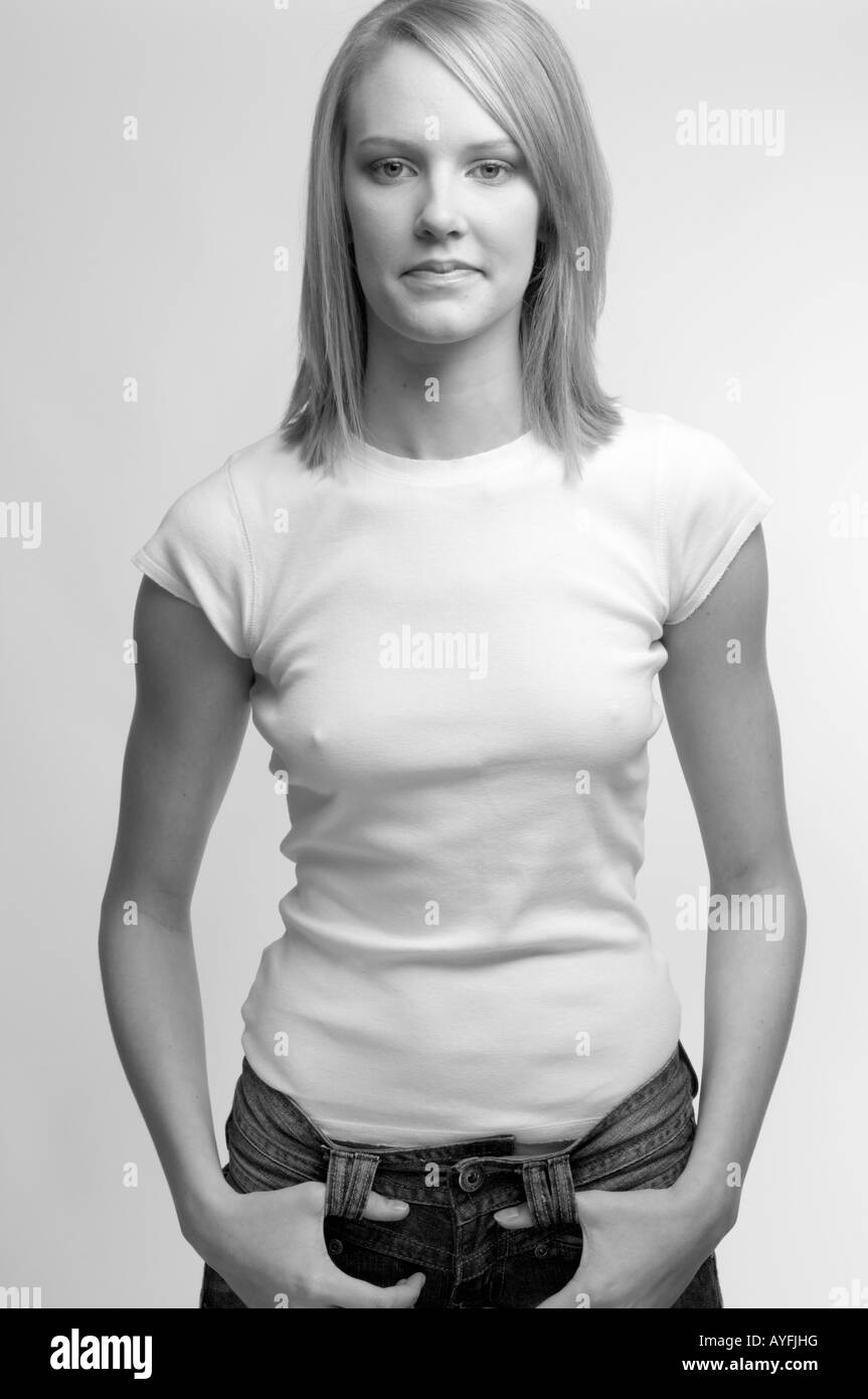 White t shirt and blue jeans - Stock Photo Young Blonde Haired Woman Wearing White T Shirt And Blue Jeans Looking Directly At Camera In Photo Studio