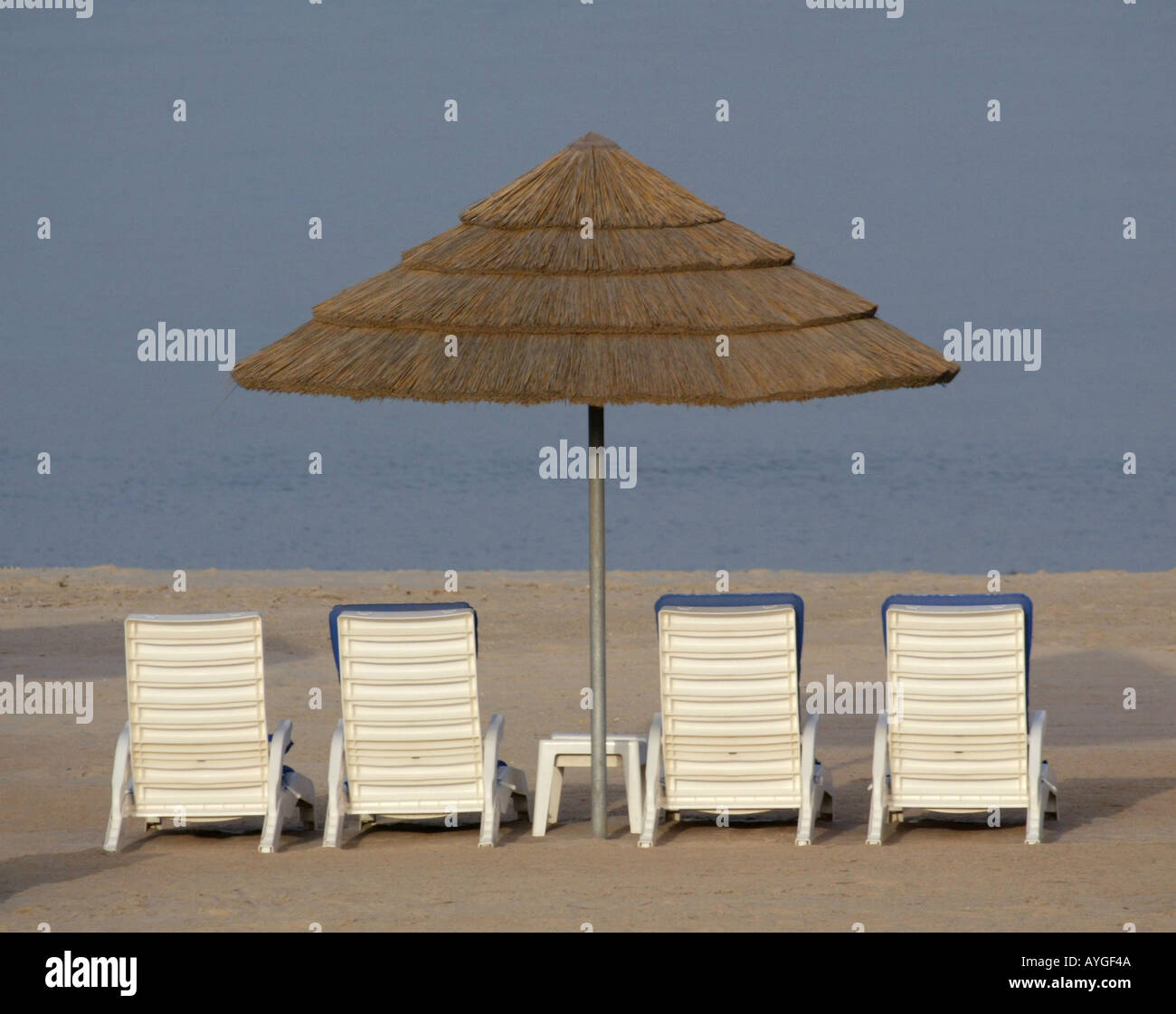 Beach chair and umbrella set - Beach Chairs And Umbrellas Set Up Along The Beach Front Of The Persian Gulf At The Hilton Resort In Kuwait