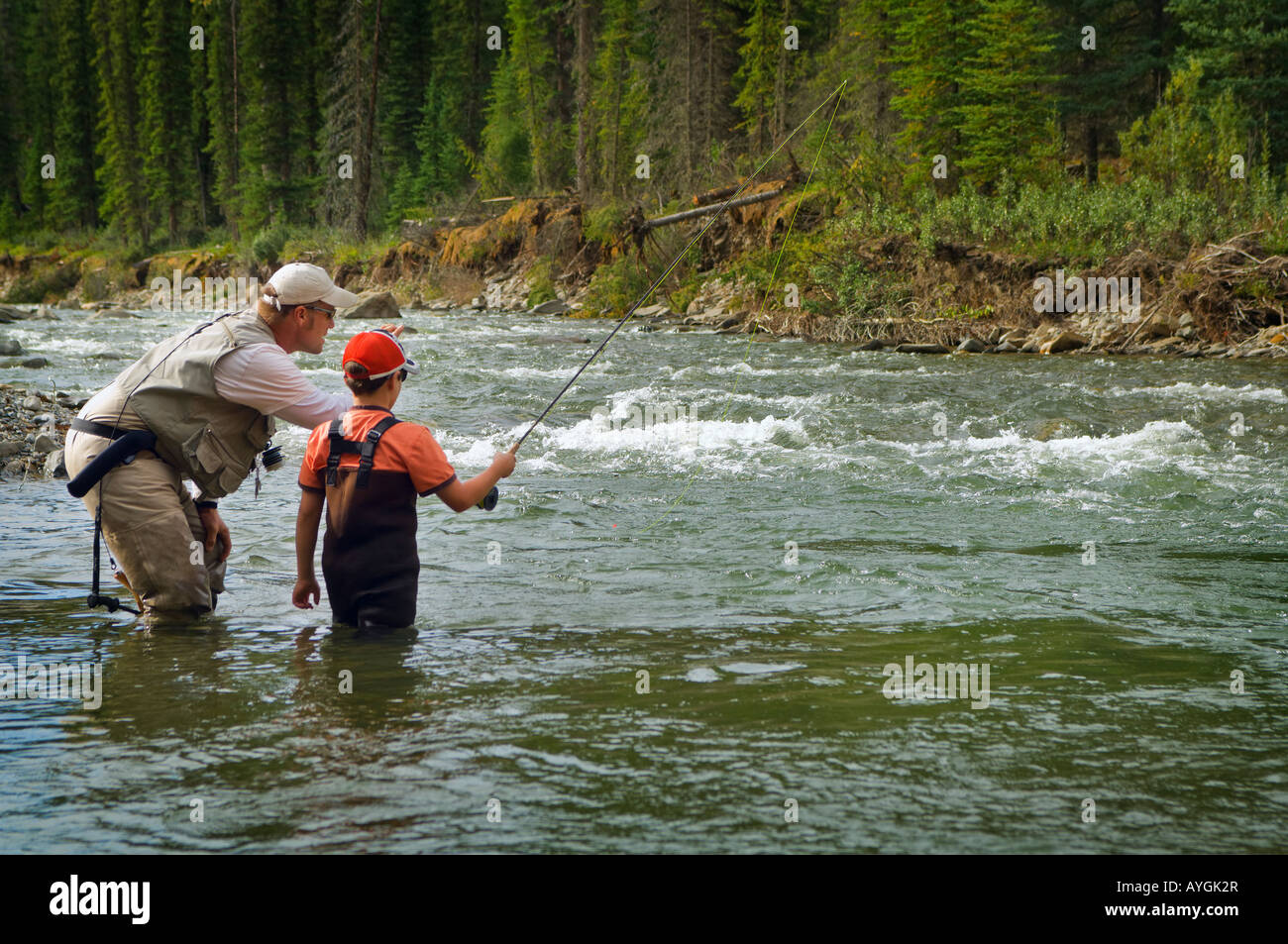 Nordegg alberta canada father and sons fly fishing in a for Father son fishing