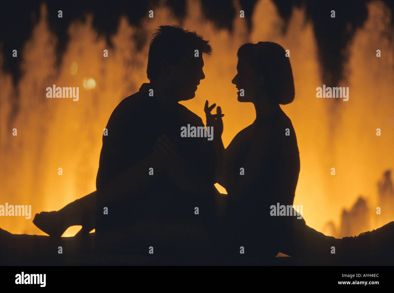 Silhouette Of Couple Talking In Front A Water Fountain Century City Area Los Angeles