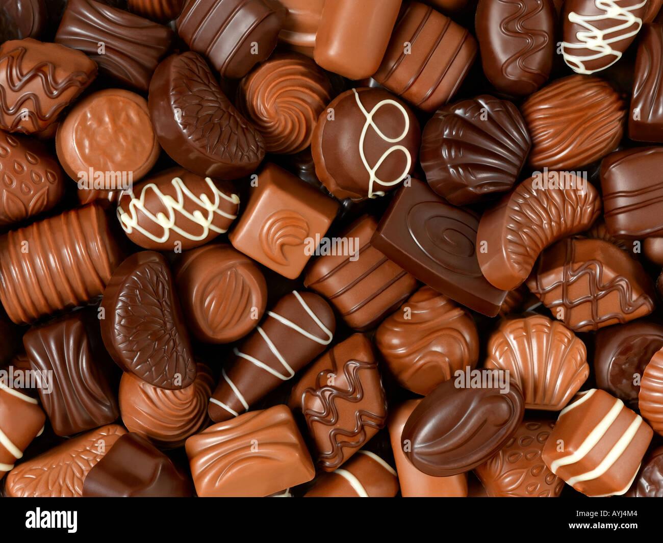 assorted chocolates background Stock Photo, Royalty Free ...