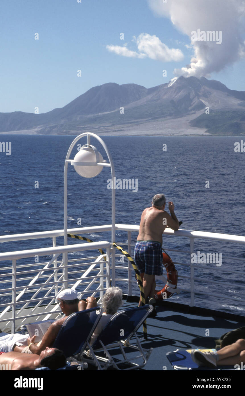 Cruise Ship Sailing Past The Still Smoking Volcano In The - Is there smoking on cruise ships